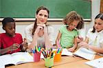 Elementary teacher giving art class Stock Photo - Premium Royalty-Freenull, Code: 6109-06007586