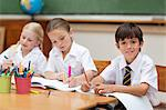 Young pupils painting at desk Stock Photo - Premium Royalty-Freenull, Code: 6109-06007608