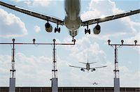 Multiple Exposure of Airplanes Landing at Airport Stock Photo - Premium Rights-Managednull, Code: 700-06009102