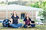 Two Teenage Girls Meditating on School Grounds Stock Photo - Premium Rights-Managed, Artist: Kevin Dodge, Code: 700-06009196