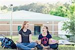 Two Girls Meditating on School Grounds
