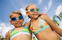 preteen girl swimsuit - Two Girls (7-9) in swimwear, portrait. Stock Photo - Premium Royalty-Freenull, Code: 693-06013547