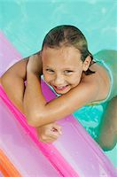 preteen swimsuit - Girl (7-9) in swimming pool, view from above, portrait. Stock Photo - Premium Royalty-Freenull, Code: 693-06013548