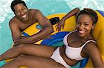 Couple Relaxing in Pool on Inflatable Raft, elevated view portrait. Stock Photo - Premium Royalty-Free, Artist: Robert Harding Images, Code: 693-06013569