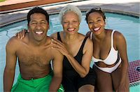 Senior woman with couple at swimming pool, elevated view portrait. Stock Photo - Premium Royalty-Freenull, Code: 693-06013575