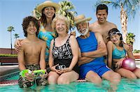 Girl (10-12) with brother (13-15), parents, and grandparents at swimming pool, portrait. Stock Photo - Premium Royalty-Freenull, Code: 693-06013585