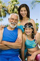 Girl (10-12) with mother and grandfather, front view portrait. Stock Photo - Premium Royalty-Freenull, Code: 693-06013586