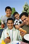 Boy (13-15) with brothers and father at outdoor picnic, portrait Stock Photo - Premium Royalty-Free, Artist: Cultura RM, Code: 693-06013613