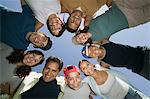 Boy (13-15) with friends and family in huddle, view from below. Stock Photo - Premium Royalty-Free, Artist: Cultura RM, Code: 693-06013622