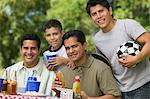 Boy (13-15) with father and brothers at picnic. Stock Photo - Premium Royalty-Free, Artist: Raymond Forbes, Code: 693-06013625