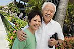 Senior couple with binoculars, smiling, outdoors, (portrait) Stock Photo - Premium Royalty-Free, Artist: Cultura RM, Code: 693-06013655