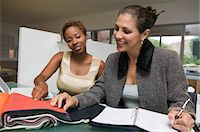 planner - Two women with laptop and organizer examining fabric swatches Stock Photo - Premium Royalty-Freenull, Code: 693-06013815