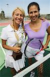 Two female Tennis Players by net on court holding trophy, portrait Stock Photo - Premium Royalty-Free, Artist: CulturaRM, Code: 693-06013850