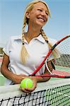 Female Tennis Player at net on tennis court Stock Photo - Premium Royalty-Free, Artist: Blend Images, Code: 693-06013853