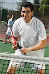 Male doubles tennis players waiting for serve, front view, focus on foreground Stock Photo - Premium Royalty-Free, Artist: Ron Fehling, Code: 693-06013865