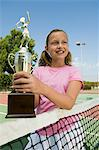 Girl at Tennis Net Holding Trophy Stock Photo - Premium Royalty-Free, Artist: ableimages, Code: 693-06013877