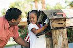 Father and Daughter checking mail at domestic Mailbox Stock Photo - Premium Royalty-Free, Artist: Mark Peter Drolet, Code: 693-06013925