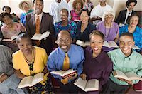 Church congregation sitting on church pews with Bible, portrait, high angle view Stock Photo - Premium Royalty-Freenull, Code: 693-06013984