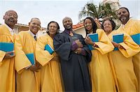 Preacher and Choir in church garden, portrait, low angle view Stock Photo - Premium Royalty-Freenull, Code: 693-06013986