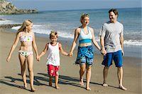 Family Holding Hands on Beach Stock Photo - Premium Royalty-Freenull, Code: 693-06014050