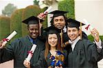 Graduates hoisting diplomas outside, portrait Stock Photo - Premium Royalty-Free, Artist: Ikon Images, Code: 693-06014180