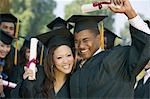 Graduates hoisting diplomas outside Stock Photo - Premium Royalty-Free, Artist: Jean-Christophe Riou, Code: 693-06014181