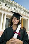 Graduate holding diploma outside university, portrait Stock Photo - Premium Royalty-Free, Artist: Ikon Images, Code: 693-06014183