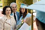 Graduate and grandparents having photograph taken outside Stock Photo - Premium Royalty-Free, Artist: Blend Images, Code: 693-06014186