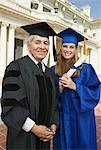 Dean and graduate outside university, portrait Stock Photo - Premium Royalty-Free, Artist: Blend Images, Code: 693-06014189