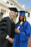 Dean and graduate outside university, portrait Stock Photo - Premium Royalty-Free, Artist: Blend Images, Code: 693-06014192