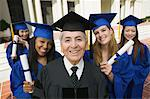 Dean and graduates outside university, elevated view, portrait Stock Photo - Premium Royalty-Free, Artist: Blend Images, Code: 693-06014193
