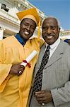 Graduate with father outside university, portrait Stock Photo - Premium Royalty-Free, Artist: Blend Images, Code: 693-06014195