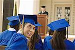 Graduates listening to speaker outside Stock Photo - Premium Royalty-Free, Artist: Blend Images, Code: 693-06014205