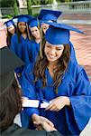 Graduate shaking hand of dean outside, elevated view Stock Photo - Premium Royalty-Freenull, Code: 693-06014207