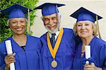 Senior graduates smiling outside, portrait Stock Photo - Premium Royalty-Free, Artist: Jean-Christophe Riou, Code: 693-06014216