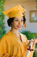 Graduate holding diploma outside, portrait Stock Photo - Premium Royalty-Freenull, Code: 693-06014219