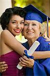 Senior graduate hugging granddaughter outside Stock Photo - Premium Royalty-Freenull, Code: 693-06014225