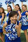 Smiling Cheerleader, (portrait) Stock Photo - Premium Royalty-Free, Artist: Blend Images, Code: 693-06014231
