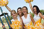 Smiling Cheerleaders holding trophy and pom-poms, (portrait) Stock Photo - Premium Royalty-Free, Artist: CulturaRM, Code: 693-06014246