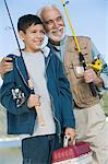 Grandfather and grandson holding fishing rods outdoors, smiling Stock Photo - Premium Royalty-Free, Artist: CulturaRM, Code: 693-06014303