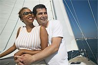 Affectionate Couple Relaxing on Yacht Stock Photo - Premium Royalty-Freenull, Code: 693-06014384