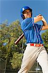 Baseball player swinging baseball bat, (low angle view) Stock Photo - Premium Royalty-Free, Artist: Cusp and Flirt, Code: 693-06014391