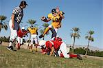 Football players in action on field, ground view Stock Photo - Premium Royalty-Free, Artist: Daisy Gilardini, Code: 693-06014424