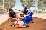 Softball player slideing into home plate Stock Photo - Premium Royalty-Freenull, Code: 693-06014486