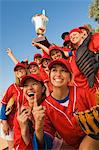 Women's softball team with trophy, portrait, low angle view Stock Photo - Premium Royalty-Free, Artist: Blend Images, Code: 693-06014489