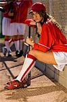 Softball player sitting on bench with bat, portrait Stock Photo - Premium Royalty-Free, Artist: Science Faction, Code: 693-06014493