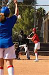 Pitcher throwing softball to batter Stock Photo - Premium Royalty-Freenull, Code: 693-06014496