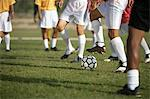 Soccer players competing for ball, low section Stock Photo - Premium Royalty-Free, Artist: Blend Images, Code: 693-06014501