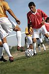 Soccer players competing for ball Stock Photo - Premium Royalty-Free, Artist: CulturaRM, Code: 693-06014502