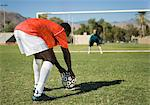 Soccer player preparing for penalty kick, back view Stock Photo - Premium Royalty-Free, Artist: Aflo Sport, Code: 693-06014507